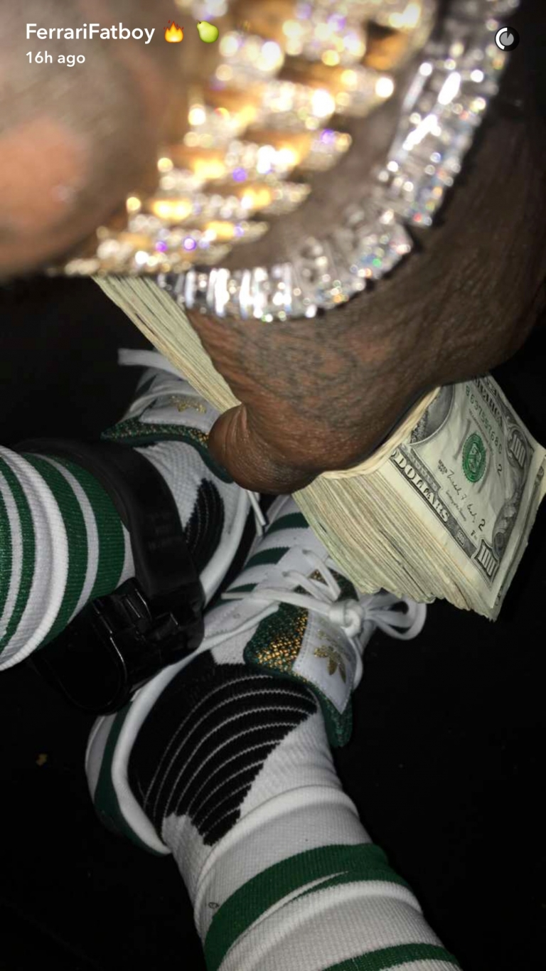 Rick Ross showing off his stacks, his bling, and his expensive cars... #ferrarifatboy
