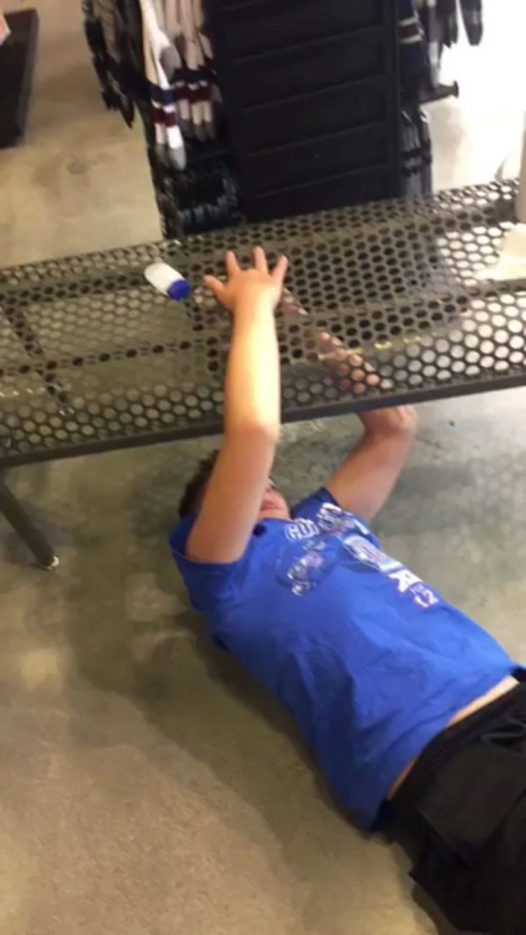 Kid got his fingers stuck in a metal bench hole