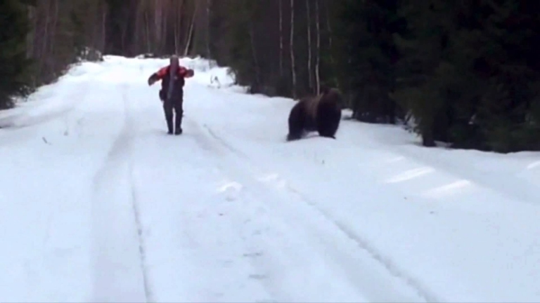 Watch This Fearless Guy Scares Off Charging Bear