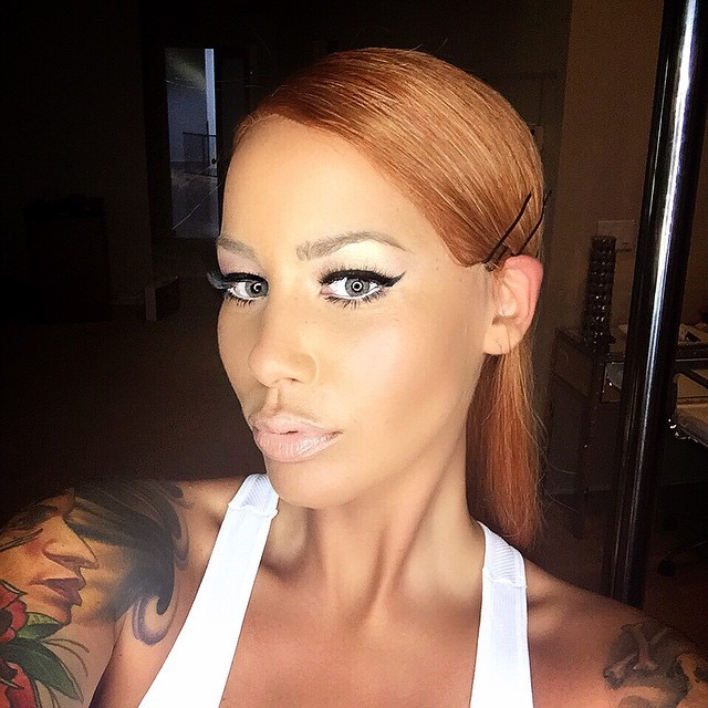 Amber Rose is unrecognizable with long hair on this Instagram photo