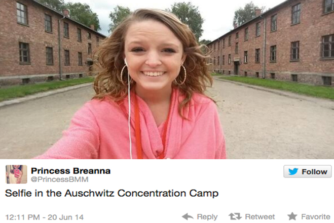 A high school graduate selfie in front of Auschwitz-Birkenau concentration camp