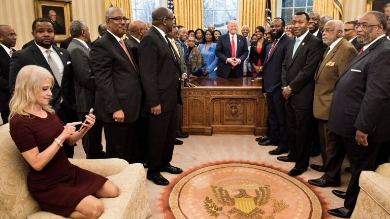 What's the fuss about Kellyanne Conway's photo sitting in the Oval Office couch?