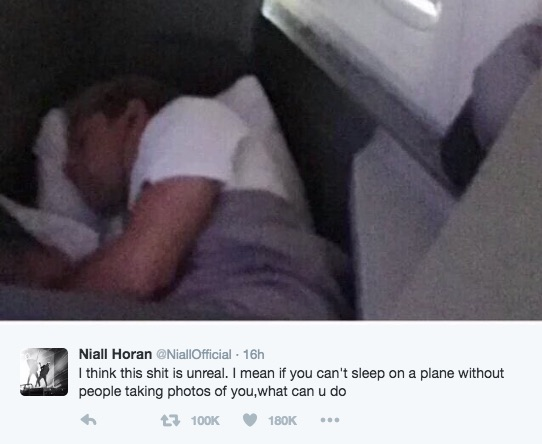 A creeper took a photo of Niall Horan while sleeping on the plane