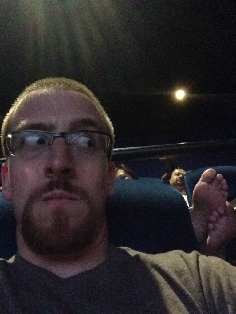 When you are in a movie theater, don't assume people wants to smell your feet