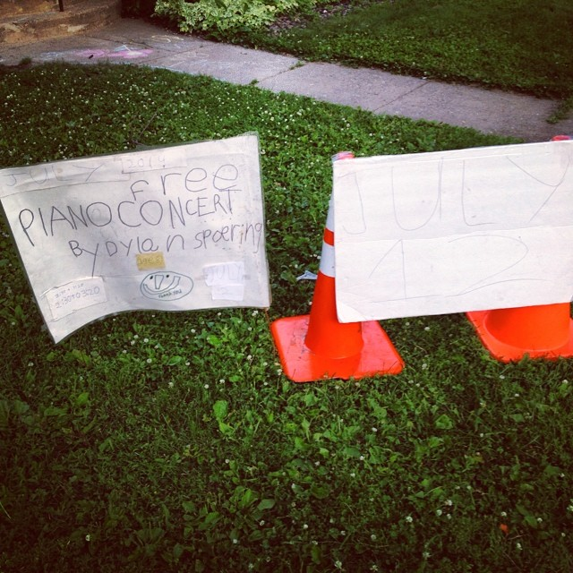 The original sign for free concert in his frontyard