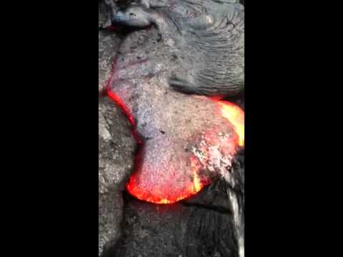 First time ever recorded on video... a dude pissing on hot flowing lava