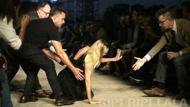 Candice Swanepoel Falls On #NYFW