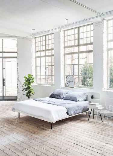 #Loft #bedroom with large windows and wood floors