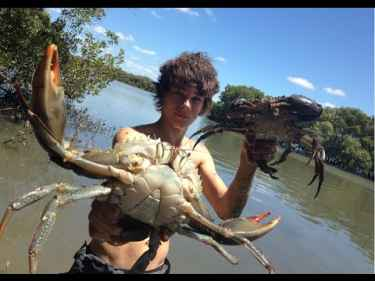 Two Aussie Teens Catch Mudcrabs Barehanded and Cook Them