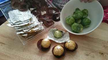 Buy ferrero roche candies, eat the candies, reuse the wrapper to wrap #sprouts for #halloween giveaway...