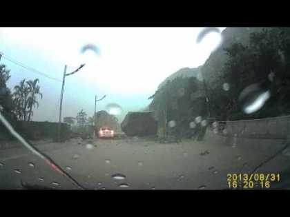 #WTF: Car Almost Crushed By Huge Boulder In China