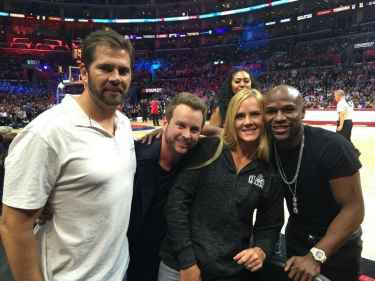 Floyd Mayweather posing with Holly Holm must be another KO for Ronda Rousey