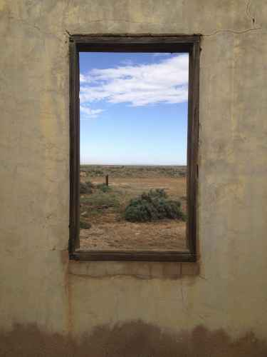 Looking through a window in Australian Outback ruin looks like a picture on a wall
