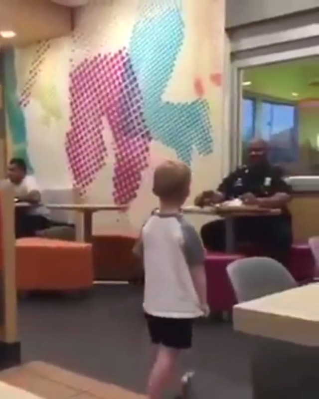 This little kid asked his mom if he could go hug the police officer