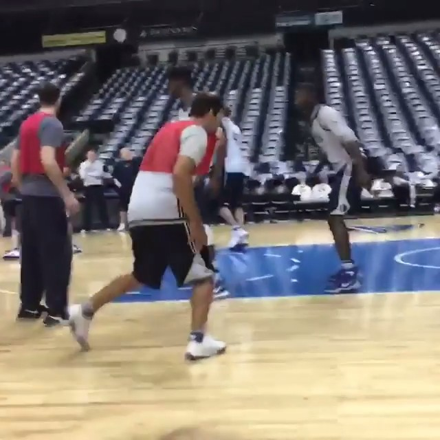 Tony Romo hits a jumper in a pickup game with the Mavericks