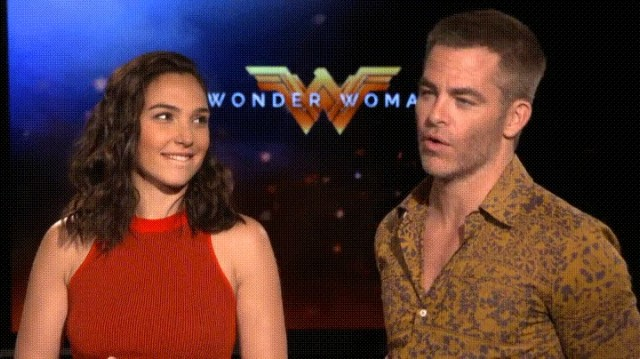Gal Gadot bit her lip as she stared and smiled at Chris Pine during an interview
